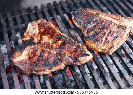 Roasted T-bone steak on barbeque.