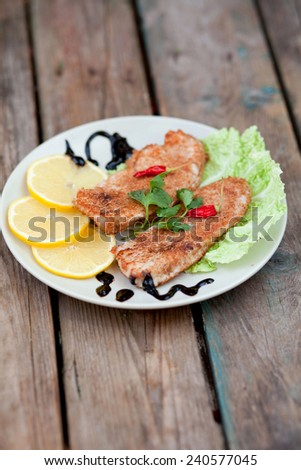 roasted turkey breast on a wooden background - stock photo