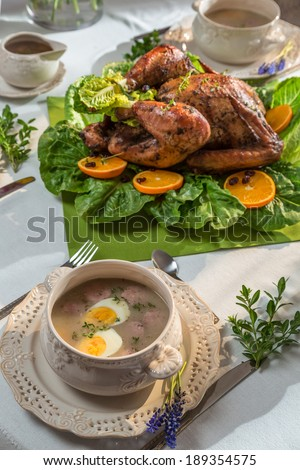 Roasted turkey for Thanksgiving served with soup - stock photo