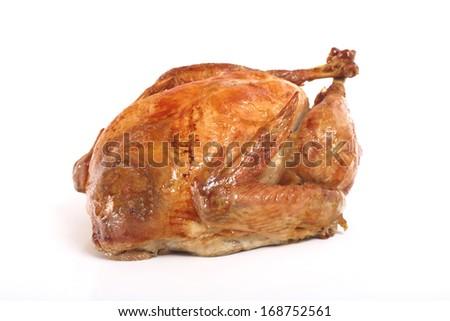 Roasted turkey, isolated on white background, shallow focus - stock photo