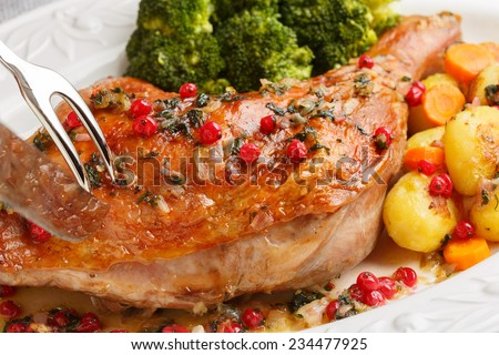 roasted turkey leg being sliced- christmas dish - stock photo