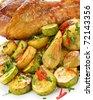 Roasted turkey leg with vegetables. Shallow dof. - stock photo