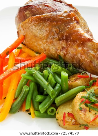 Roasted turkey leg with vegetables. Shallow dof.