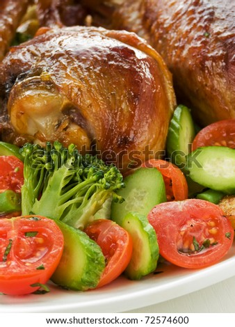 Roasted turkey legs with vegetables. Shallow dof.