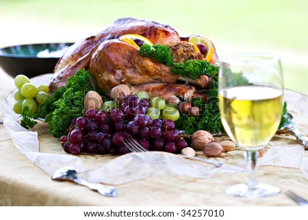 Roasted turkey on holiday table ready to eat. - stock photo