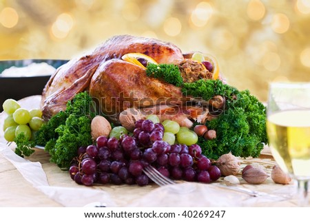 Roasted turkey on holiday table ready to eat. Selective focus on turkey. - stock photo