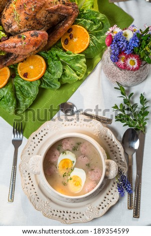 Roasted turkey served with barley sour soup - stock photo