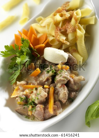 Roasted veal with pasta - stock photo