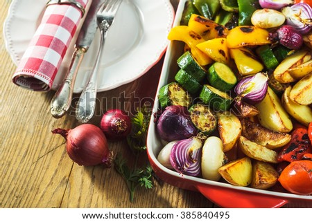 roasted vegetables in a ceramic pot - stock photo