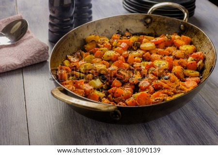 Roasted vegetables in a metal serving bowl - stock photo