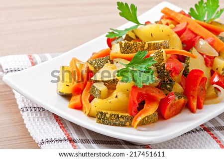 Roasted vegetables - zucchini, tomatoes, carrots, onions and paprika