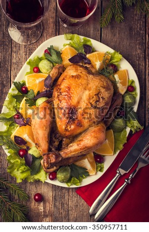 roasted whole chicken for Christmas dinner, top view - stock photo