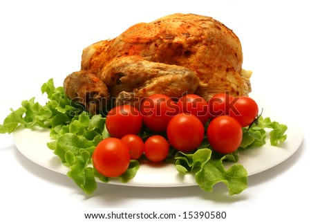 roasted whole chicken on lettuce with cherry tomato - stock photo
