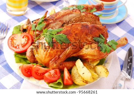 roasted whole chicken stuffed with liver for dinner - stock photo