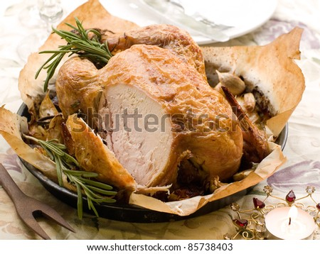 Roasted whole chicken with rosemary and garlic for Christmas dinner. Selective fous - stock photo