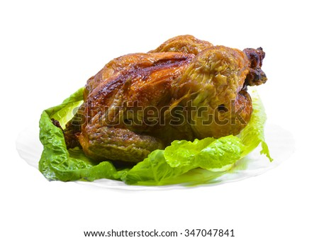 Roasted whole chicken with salad on a plate isolated