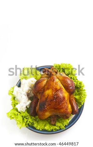 Roasted whole chicken with vegetable and potato salad; isolated on white