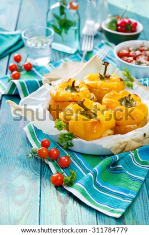 Roasted yellow peppers stuffed with quinoa, mushrooms and cheese. A delicious and healthy vegetarian meal - stock photo