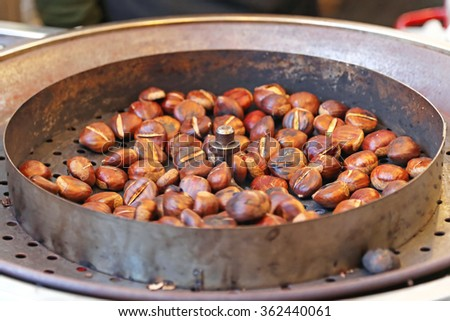 Roasting Chestnuts at Automated Rotary Grill - stock photo