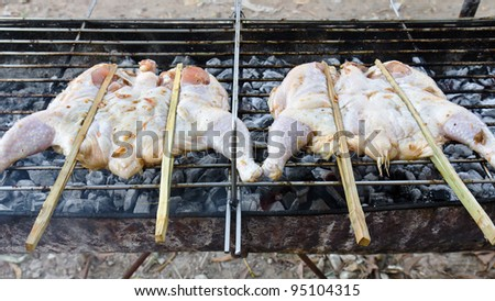 Roasting chicken on the chargrill