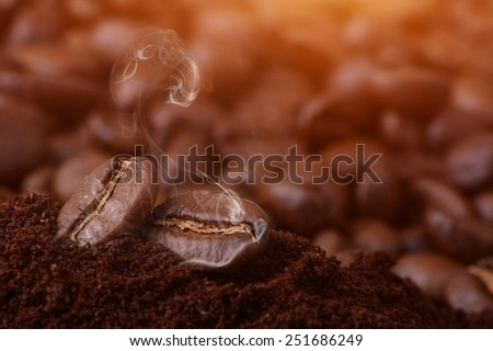 roasting coffee with smoke - stock photo