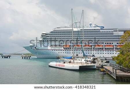 ROATAN, HONDURAS- APRIL 12, 2016: Big docked cruise liner- Carnival splendor - stock photo