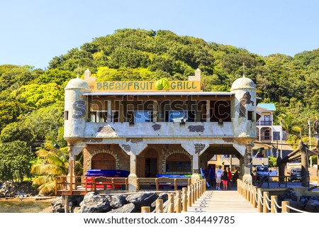 ROATAN ILAND HONDURAS JAN 28 2016: Coxen Hole, also called Roatan Town, is the largest city on the island of Roatan, and the capital of the Bay Islands of Honduras, with a population of 5,070 - stock photo