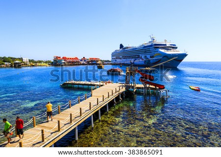 ROATAN ILAND HONDURAS JAN 28 2016:Ctruise ships docked near the bay at Coxen Hole, Roatan Town,  with a population of 5,070, Favorite spot for cruise ships and tropical lover vacationers - stock photo