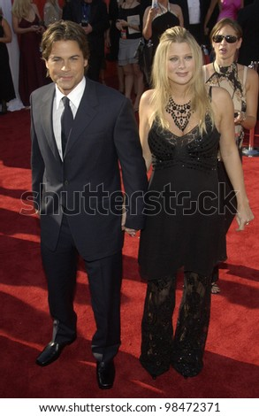 ROB LOWE & wife at the 55th Annual Primetime Emmy Awards in Los Angeles. Sept 21, 2003  Paul Smith / Featureflash