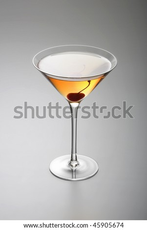 Rob Roy or Manhattan mixed drink  with cherry garnish  on grey background - stock photo