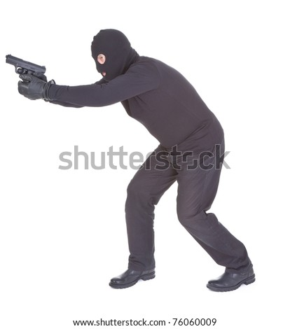 robber aiming with his gun isolated on white background - stock photo