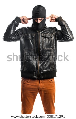 Robber covering his ears - stock photo