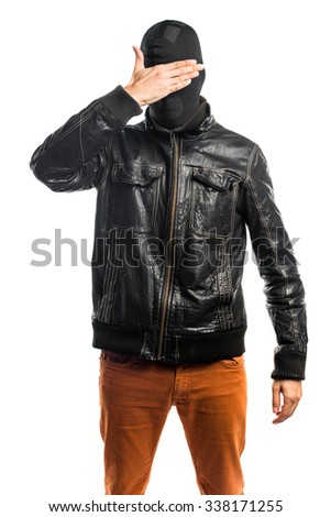 Robber covering his eyes - stock photo