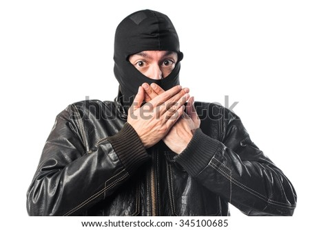 Robber covering his mouth
