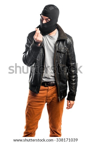 Robber doing a money gesture - stock photo