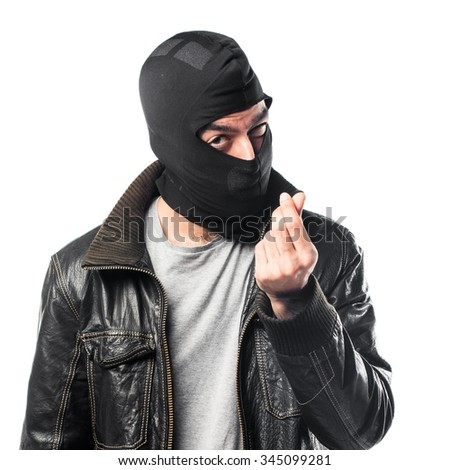 Robber doing a money gesture