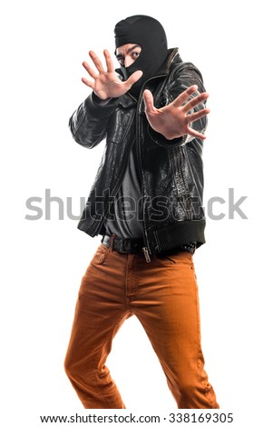 Robber doing surprise gesture - stock photo