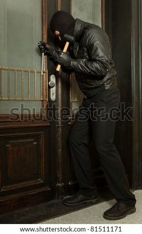 robber doing work - stock photo