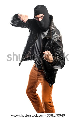 Robber giving a punch - stock photo