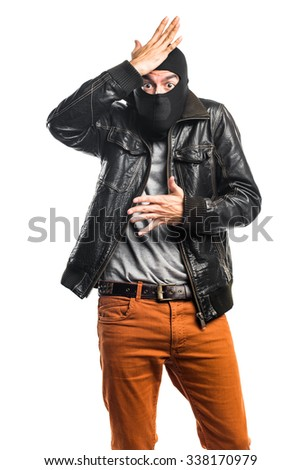 Robber having doubts - stock photo