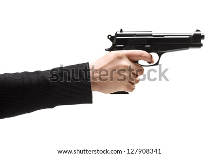 Robber holding a gun isolated against white background - stock photo