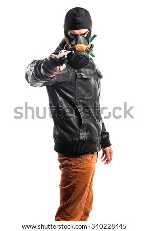 Robber holding a pistol - stock photo