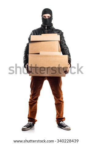 Robber holding boxes - stock photo