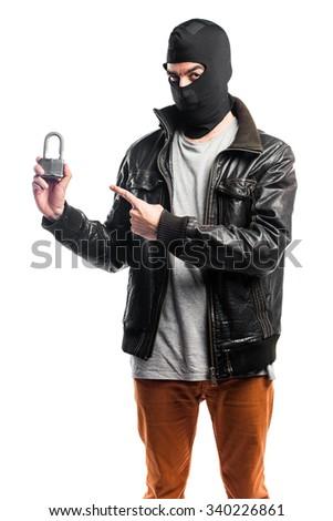 Robber holding vintage padlock - stock photo