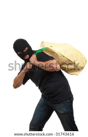 Robber in a mask carries big bag with money - stock photo
