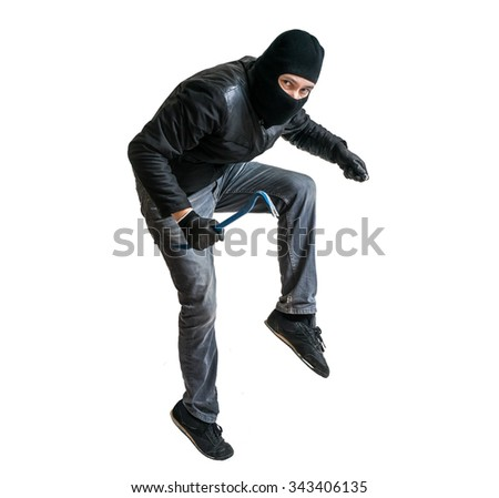 Robber in balaclava or burglar creeping on tiptoe. Isolated on white. - stock photo
