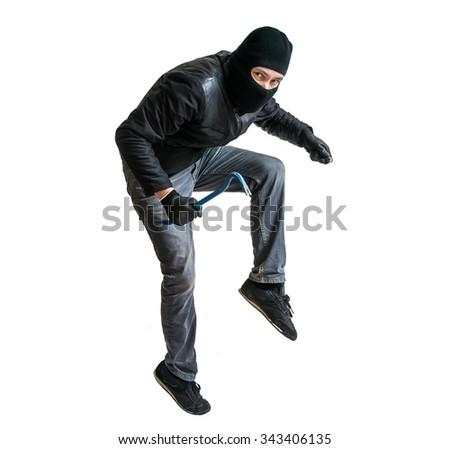 Robber in balaclava or burglar creeping on tiptoe. Isolated on white. - stock photo
