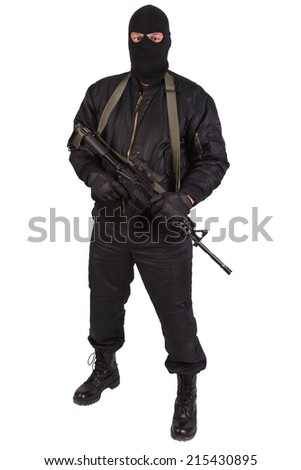 robber in black uniform and mask with m4 rifle isolated - stock photo
