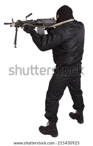 robber in black uniform and mask with machine gun - stock photo