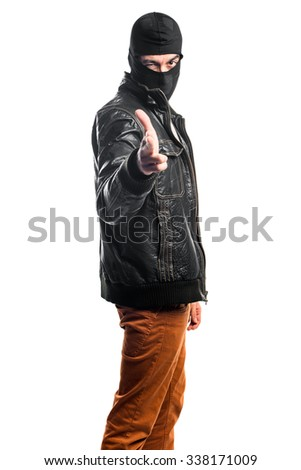 Robber making gun gesture - stock photo